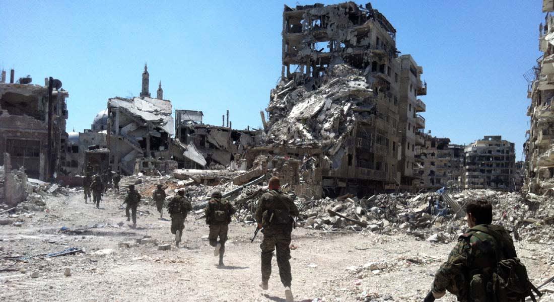 انسحاب مقاتلي المعارضة من حمص يتواصل وغليون يرد: سيعودون منتصرين