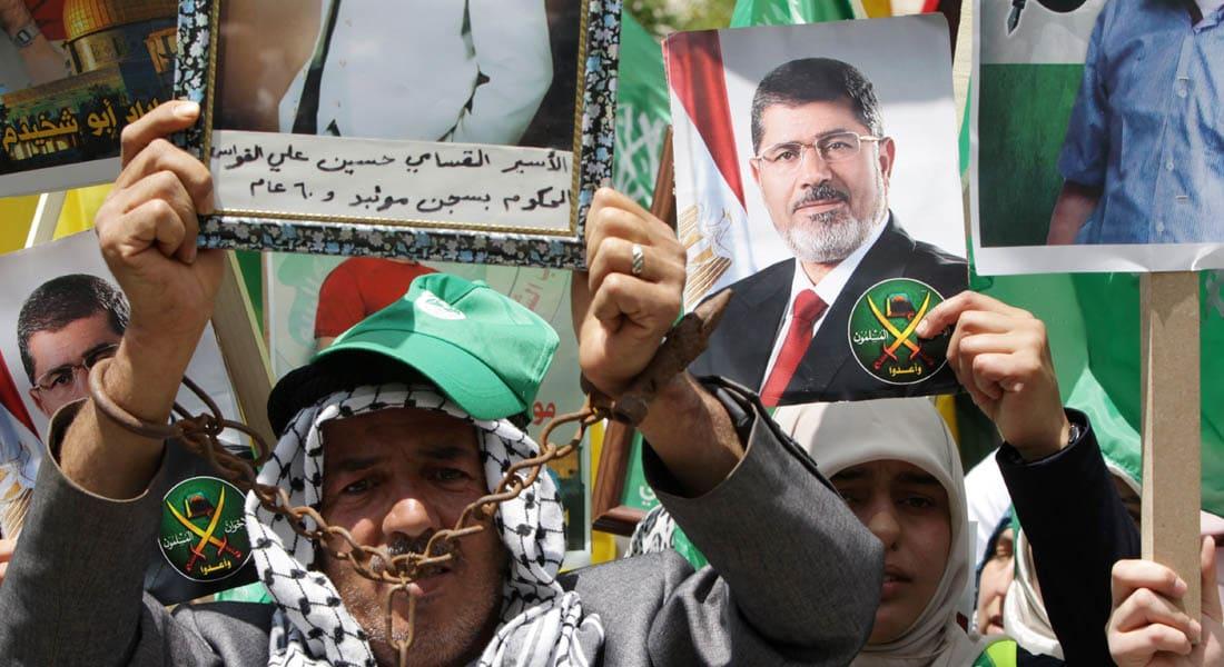 """حماس تدعو صباحي لعدم """"تكسير عظام"""" الفلسطينيين.. وفتح تنتقد رفعها لصور مرسي"""