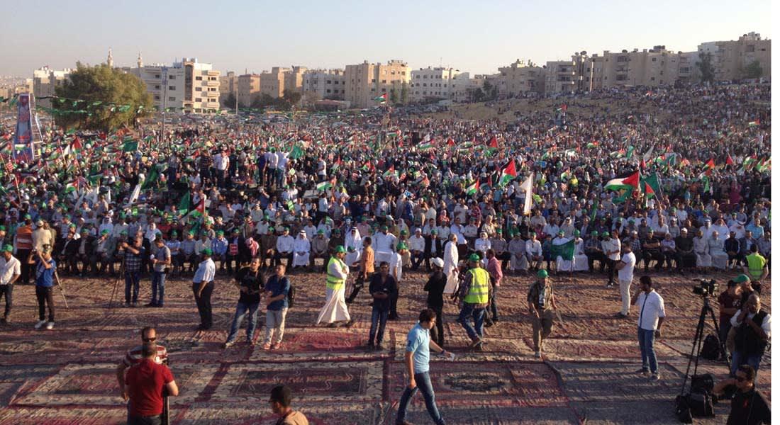 """أعلام حماس وكلمة لمشعل في احتفال إخوان الأردن """"بانتصار غزة"""""""