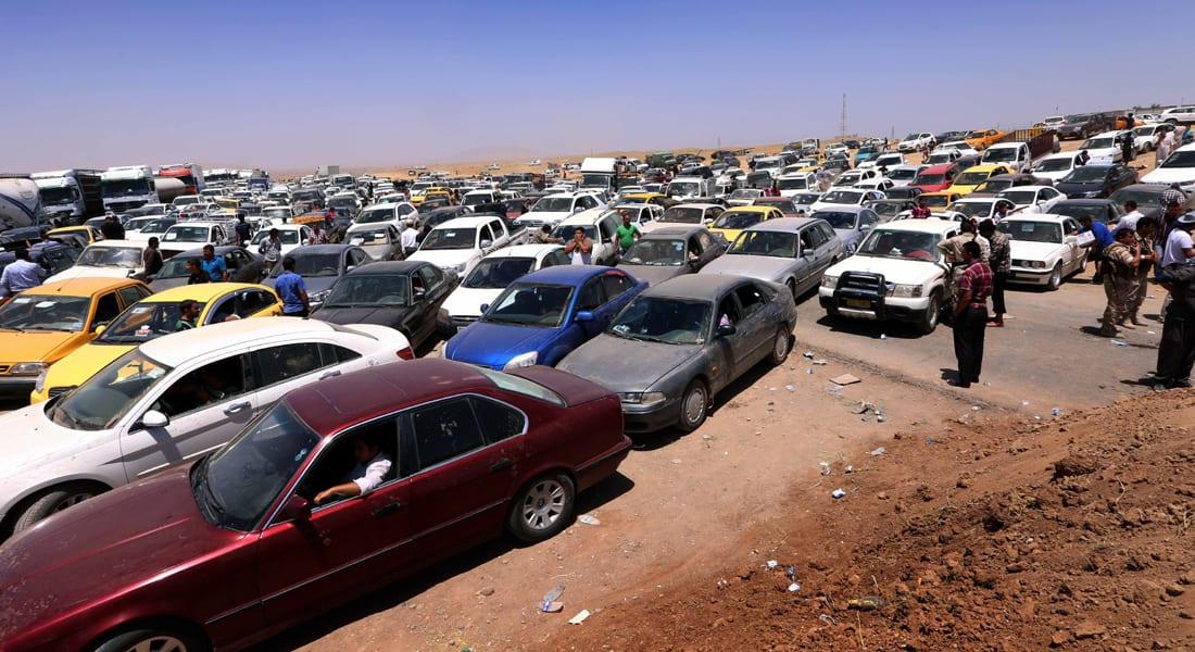 """500 ألف عراقي يفرون من الموصل وداعش تناديهم """"عودوا للمناطق المحررة"""""""