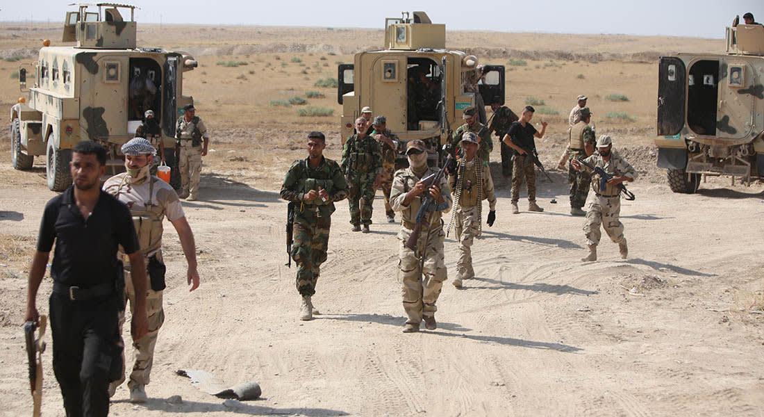 صحف العالم: صور تذكارية في العراق على جثث مقاتلي داعش