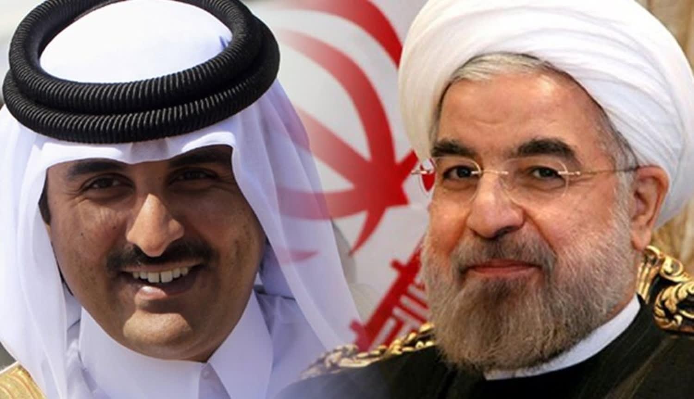 الرئيس الإيراني حسن روحاني وأمير قطر الشيخ تميم بن حمد