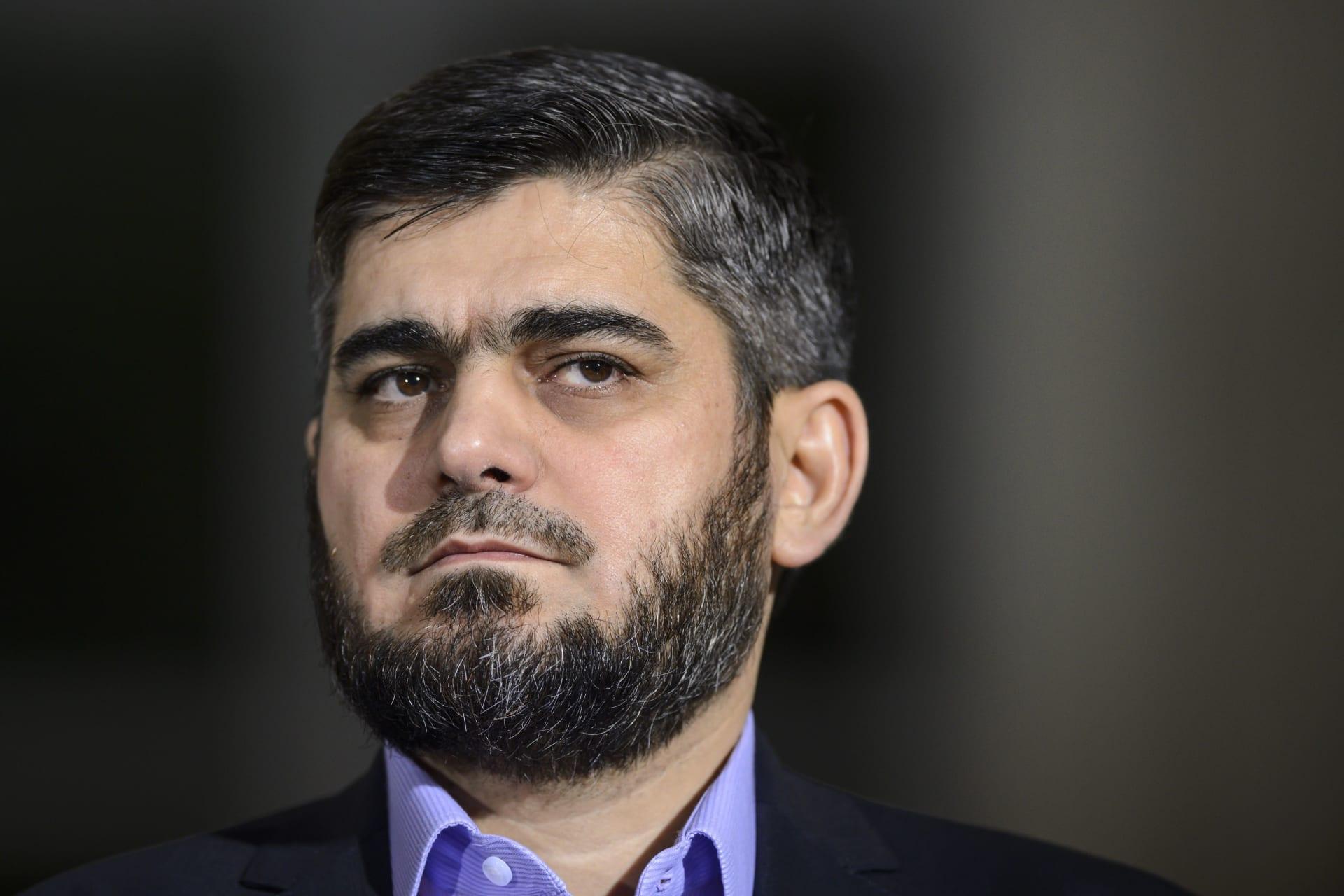علوش يستقيل من منصب كبير مفاوضي المعارضة السورية بسبب تعنت الأسد وعجز المجتمع الدولي
