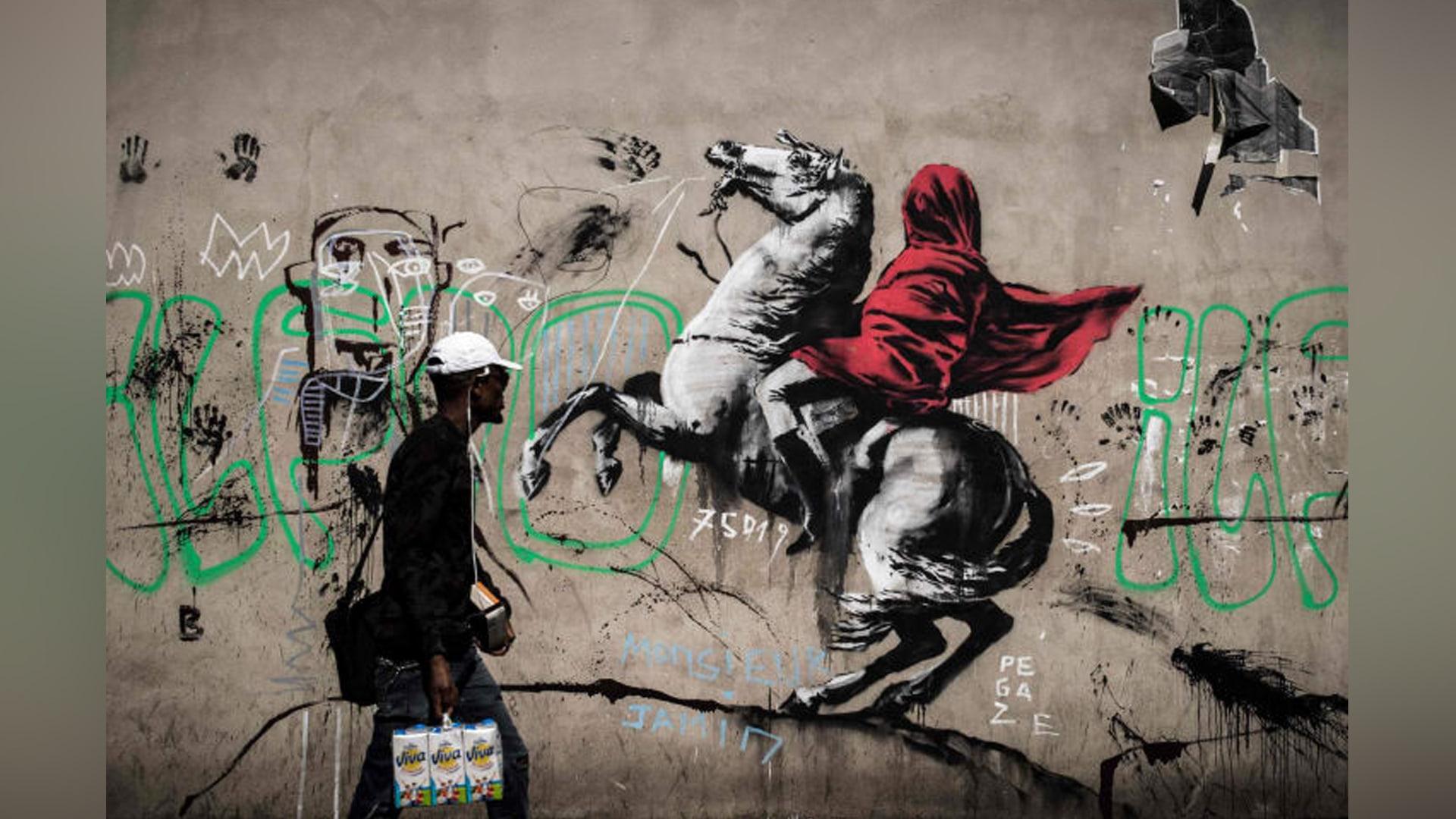 رسومات بانكسي الجديدة بشوارع باريس..تلقي الضوء على أزمة اللاجئين