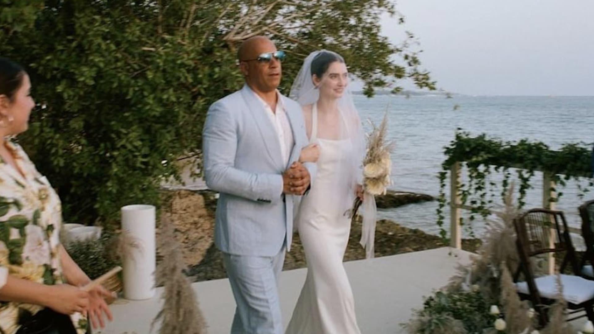 شاهد سير الممثل فان ديزل بجانب ابنة صديقه الراحل بول ووكر في حفل زفافها