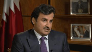"""بالفيديو.. أمير قطر يدافع عن استضافة كأس العالم  واتهامات """"استعباد العمالة"""""""
