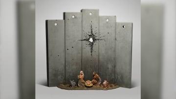 """""""ندبة بيت لحم"""".. بانكسي يكشف نسخة معدلة من مشهد ولادة المسيح"""