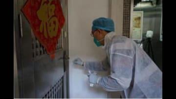 اكتشاف فيروس كورونا على مقبض باب شقة أحد المرضى في ووهان