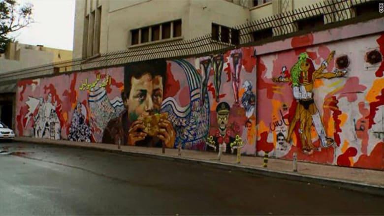 """""""الغرافيتي"""" رسوم تصرخ للثورة بأحياء مصر"""