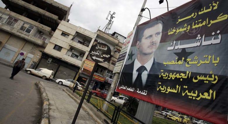"""الزعبي ينفي الاتصال بقطر """"تحت الطاولة"""": أغلبية ساحقة تؤيد بقاء الأسد بمنصبه"""