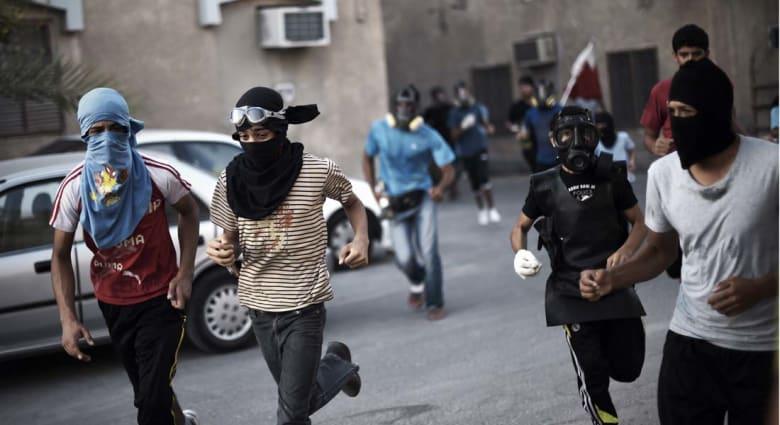 أحكام بالسجن وسحب الجنسيات على 13 بحريني بتهم تشمل التخابر مع إيران