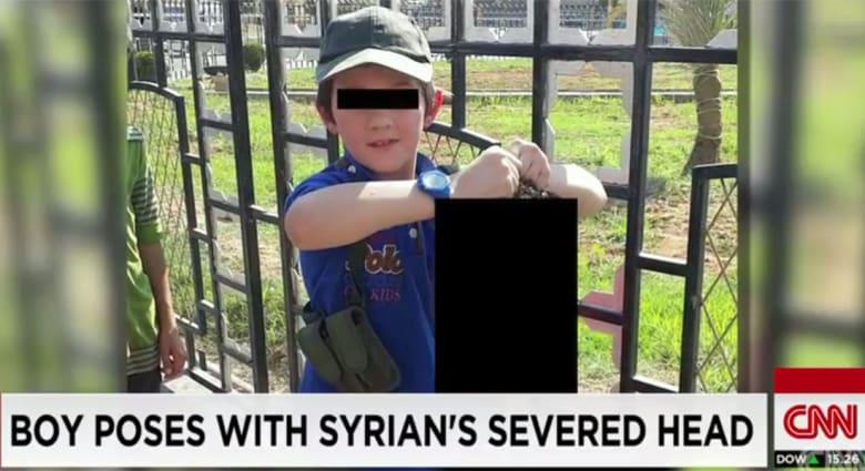 خالد شروف استرالي من داعش صوّر نجله يحمل رأس رجل وكيري يرد: عمل مثير للغثيان