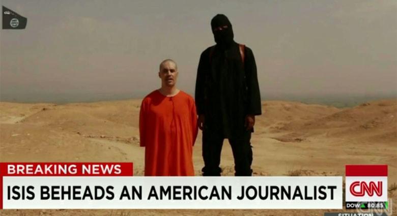 """تنظيم """"داعش"""" يعرض فيديو قطع رأس صحفي أمريكي ويهدد بقتل آخر بحال استمرار الغارات الأمريكية"""