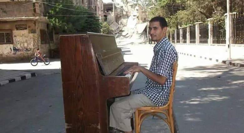 """هنا """"اليرموك"""".. لم يبقَ إلّا صوت الموسيقى بين أزقة المخيم"""