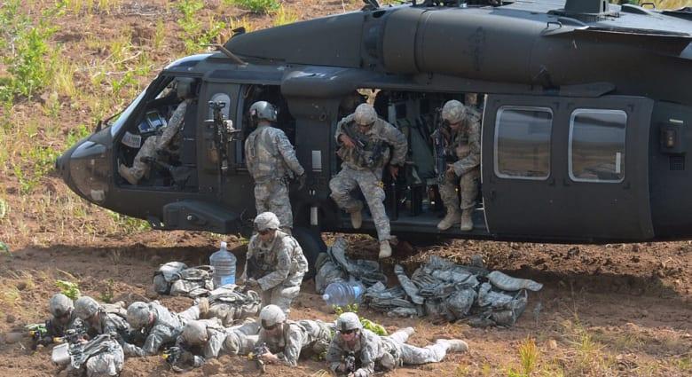 """تفاصيل عملية """"أبوسياف"""" حصريا على CNN: قوة دولية من 100 عنصر اقتحمت موقع داعش والتنظيم يصيب طائرة بلاكهوك"""