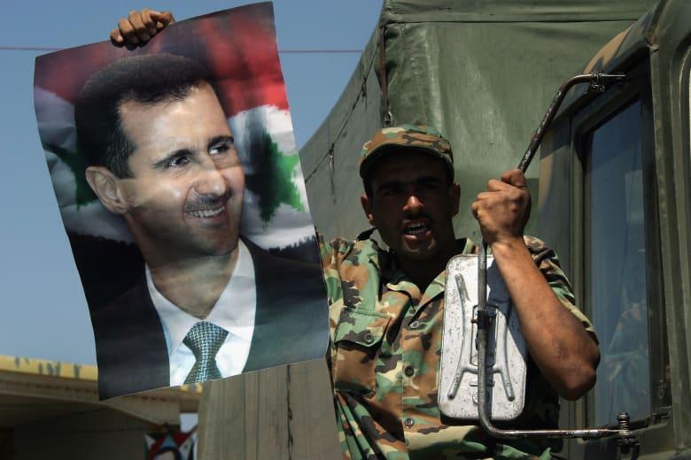 """رأي: لن يستطيع الأسد إدارة سوريا حتى إن سيطر عسكرياً.. و""""الحشد الشعبي"""" و""""حزب الله"""" نموذجان لما قد تواجهه دمشق"""