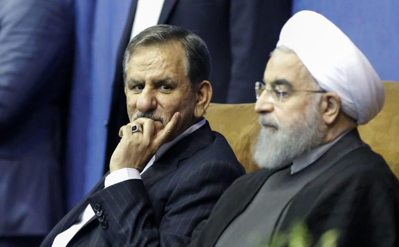 نائب الرئيس الإيراني ينسحب من الانتخابات ويدعو للتصويت لروحاني