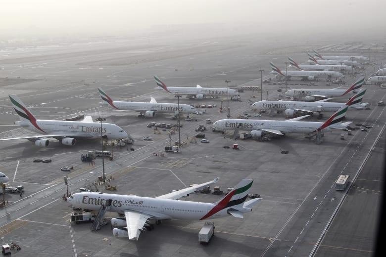 """عودة حركة الطيران إلى طبيعتها بمطار دبي بعد تعليق مؤقت بسبب """"درون"""""""