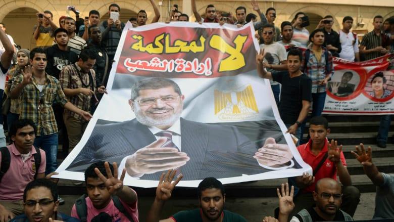 """نجل مرسي ينتقد محاكمة والده وابنة الشاطر تمتدح """"صبر"""" شقيقها"""