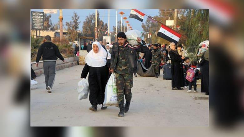 عائلات سورية تعود إلى معضمية الشام