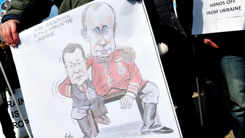 """حرب """"تهديدات"""" بين روسيا والغرب وكييف تطلب تسليم يانكوفيتش"""