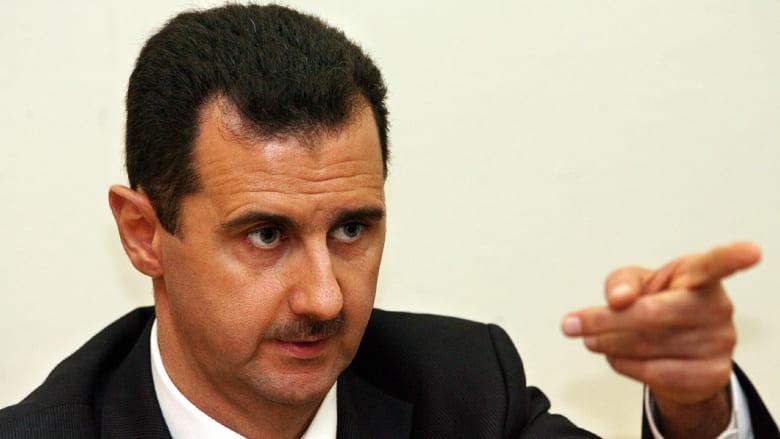 """الأسد:  محاربة الإرهاب لا تكون على يد من يدعمه..وشمخاني يشكك في """"شرعية"""" التحالف ضد """"داعش"""""""