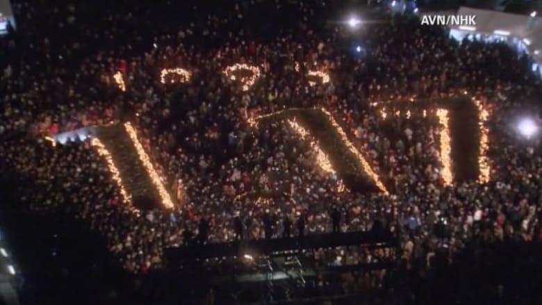 """اليابانيون يستذكرون زلزال """"هانشين"""" ويكتبون تاريخ المأساة بأجسادهم"""