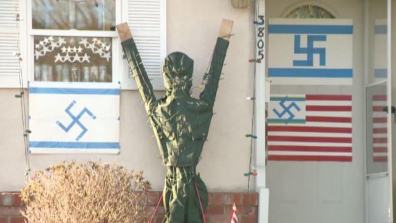 بالفيديو.. صليب معقوف على العلم الأمريكي يثير ضجة