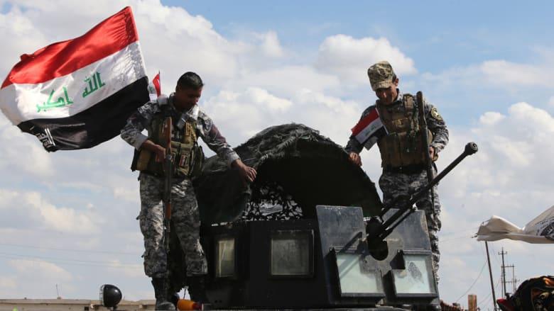 عناصر أمن عراقية بمدخل مدينة العلم، شمال تكريت