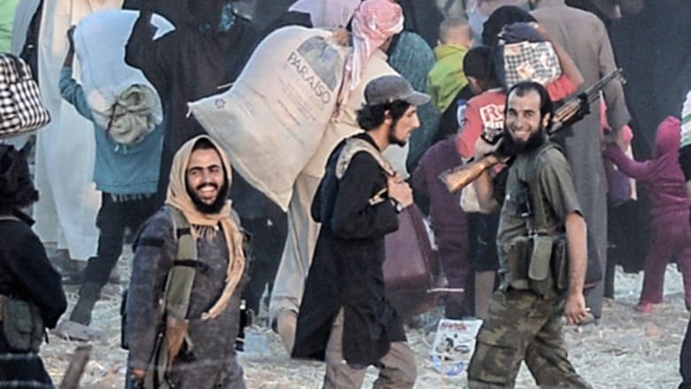 مسلحو داعش على حدود تركيا.. وعبور 13 ألف لاجئ سوري بأسبوع
