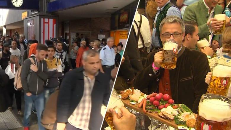 """ميونيخ منقسمة بحدثين يعكسان تناقضات العالم.. تدفق اللاجئين الباحثين عن مأوى وزحف السياح لمهرجان البيرة """"أكتوبرفيست"""""""