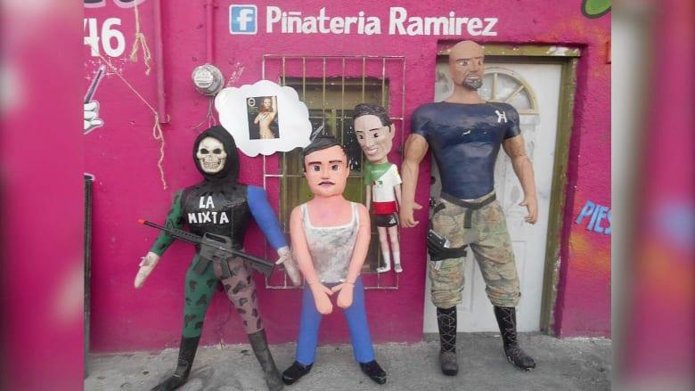 """شاهد.. صور وتذكارات """"إل تشابو"""" تنتشر في شوارع وأسواق المكسيك"""