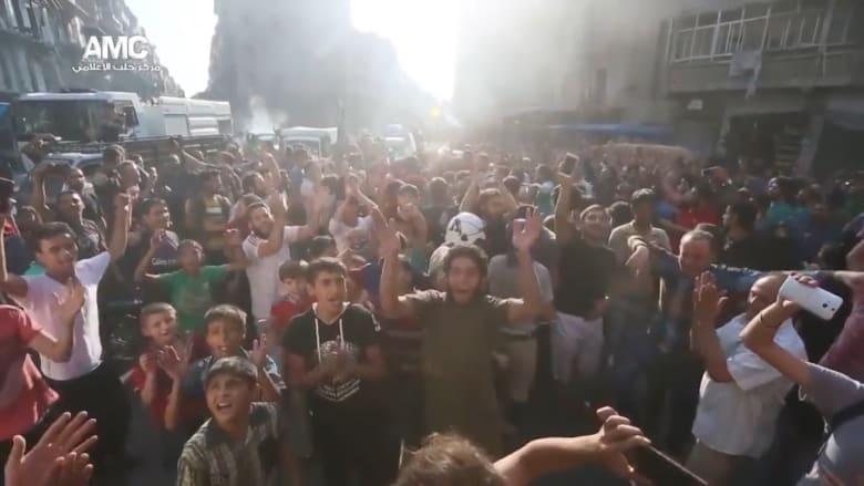 شاهد احتفالات سكان في حلب بفك الحصار عن مناطقهم داخل المدينة
