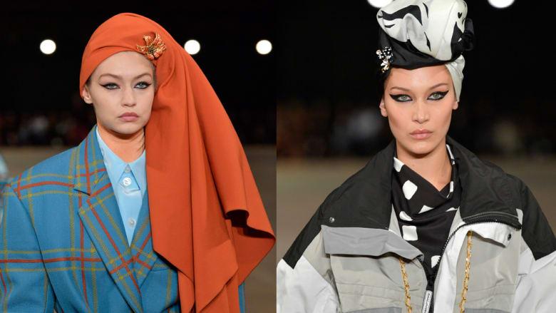 الشقيقتان جيجي وبيلا حديد تغطيان رأسيهما بعرض للأزياء
