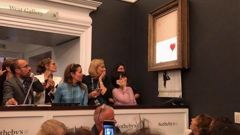 بعد بيعها بـ1.4 مليون دولار.. هكذا مزقت لوحة بانكسي نفسها