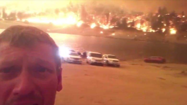 في مشهد يحبس الأنفاس.. لحظة إنقاذ أب وعائلته من حرائق مستعرة بكاليفورنيا