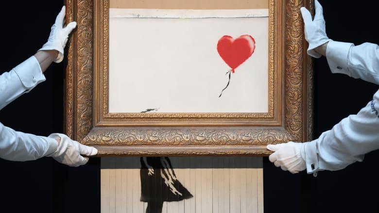 """3 سنوات بعد تمزيقها..لوحة بانكسي الشهيرة تُعرض للبيع مرة أخرى بمبلغ """"خيالي"""""""