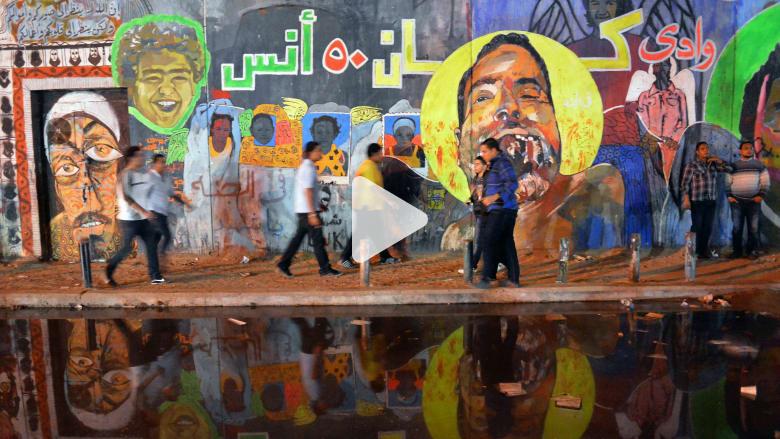 رسوم تتظاهر في ثورة فنية بشوارع القاهرة