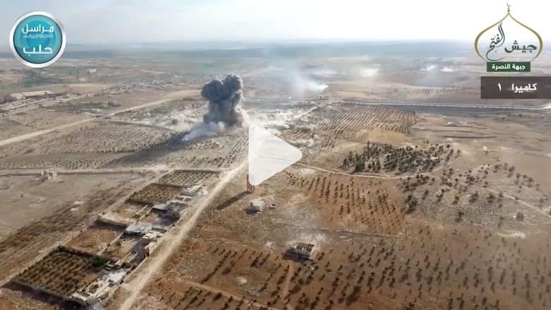 من طائرة بدون طيار.. شاهد لحظة تفجير النصرة سيارة مفخخة استهدفت القوات السورية قرب حلب