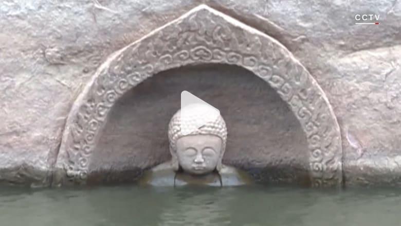 ظهور غير متوقع.. تمثال أثري لبوذا منذ 600 عام يخرج من تحت الماء