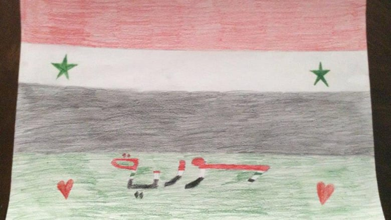 صورة للعلم السوري رسمها كريم بشار الأسد