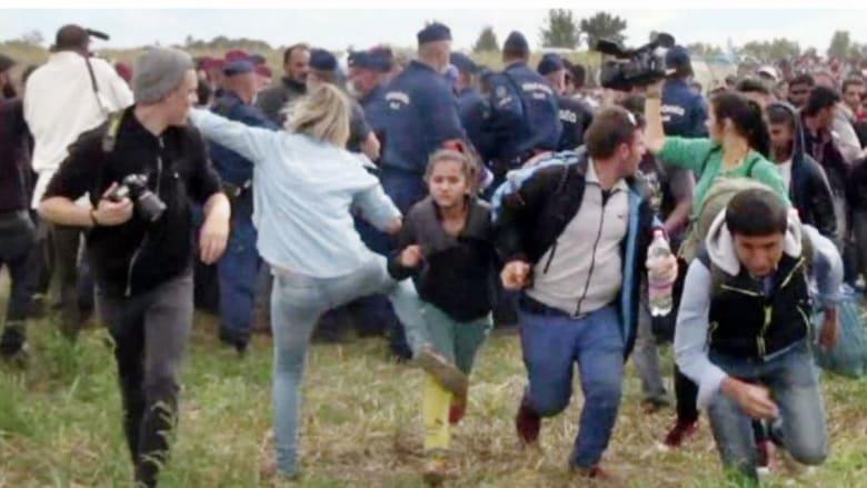 ما عقوبة المصورة المجرية لركلها وعرقلتها لاجئين سوريين؟