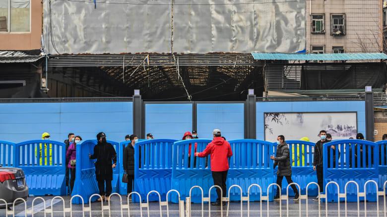 """""""كان الأمر غريبا"""".. فريق منظمة الصحة العالمية يزور سوق ووهان في الصين"""